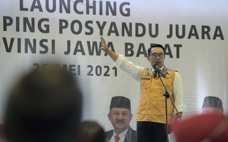 Gubernur Jabar Ridwan Kamil saat meluncurkan Pendamping Posyandu Juara di Horison Green Forest Lembang, Kabupaten Bandung Barat, Selasa (25/5 - 2021).