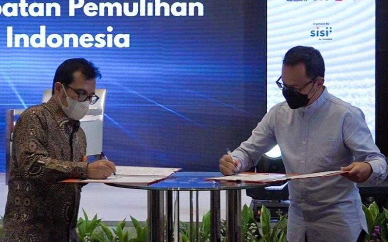 PT Pos Indonesia (Persero) melakukan penandatanganan MoU dengan Asosiasi Pemerintah Kota Seluruh Indonesia (APEKSI).
