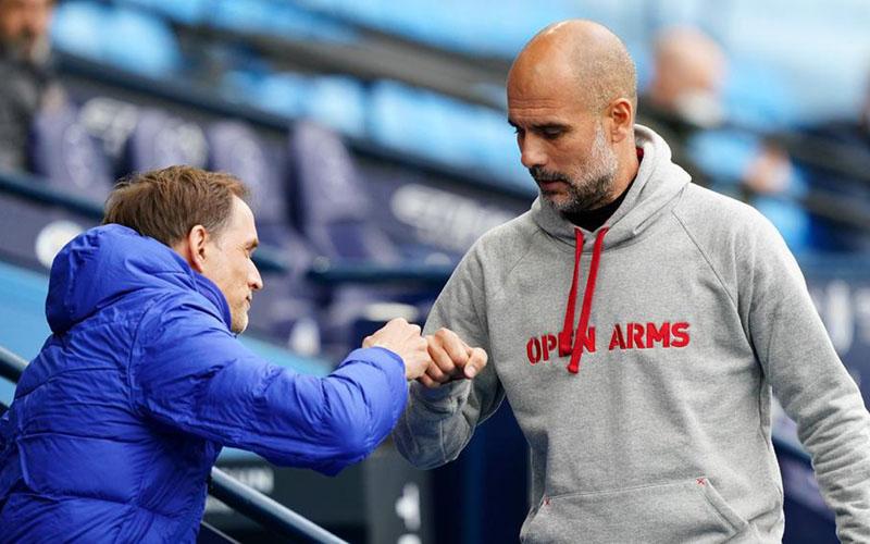 Pelatih Chelsea Thomas Tuchel (kiri) dan pelatih Manchester City Pep Guardiola. - Bein Sports