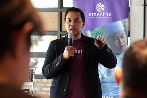 CEO dan Founder PT Amartha Mikro Fintek (Amartha) Andi Taufan Garuda Putra, memberikan paparan saat konferensi pers Amartha8eyond di Jakarta, Selasa (22/5 - 2018).JIBI/Dwi Prasetya