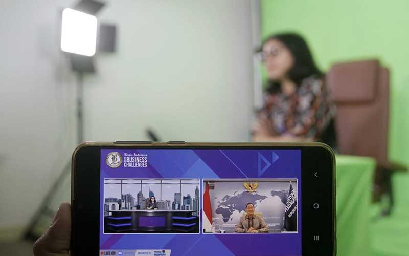 Layar menampilkan Menteri Perdagangan Muhammad Lutfi memberikan pemaparan dalam acara Bisnis Indonesia Business Challenges 2021 di Jakarta, Selasa (26/1/2021). Bisnis - Himawan L Nugraha