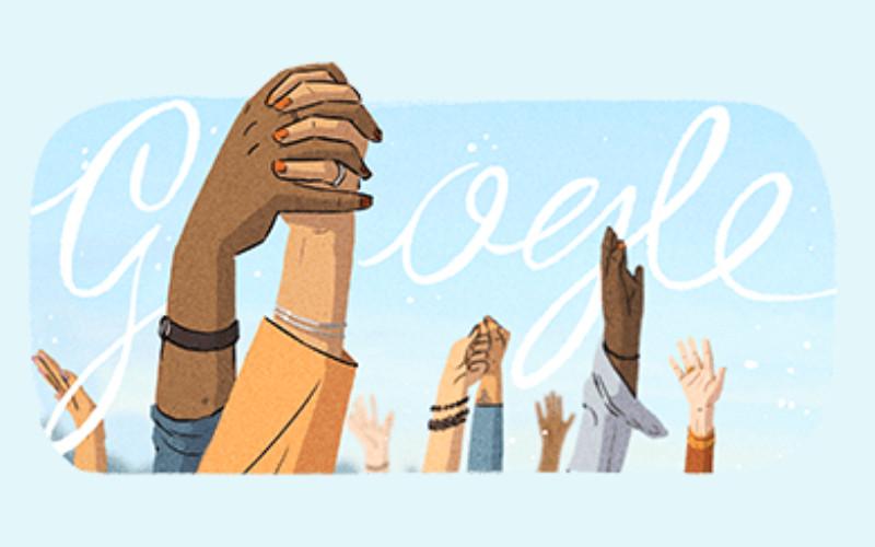 Doodle memberi penghormatan kepada para pahlawan dengan menggambarkan tangan yang telah membuka pintu bagi wanita selama beberapa generasi.  - Google