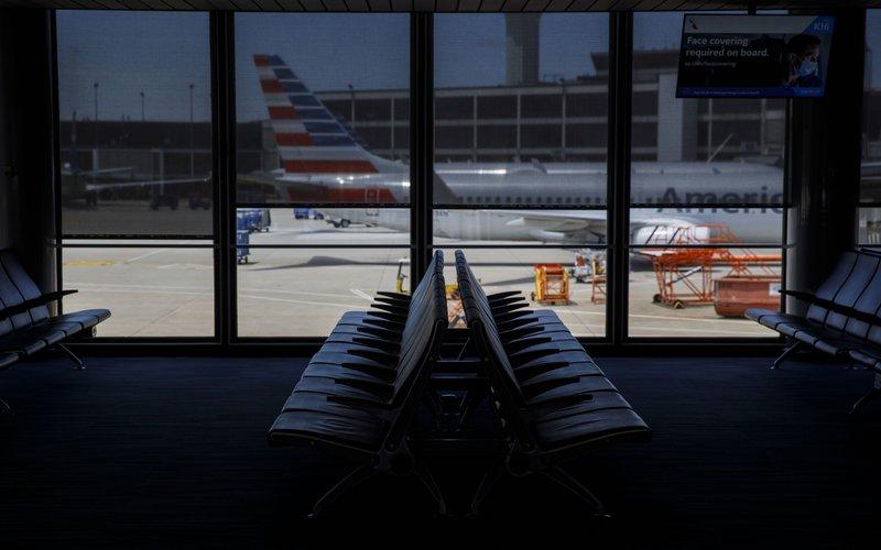 Pesawat milik American Airlines Group Inc. diparkir di bandara O'Hare International Airport (ORD) di Chicago, Illinois, AS -  Bloomberg / Patrick T. Fallon