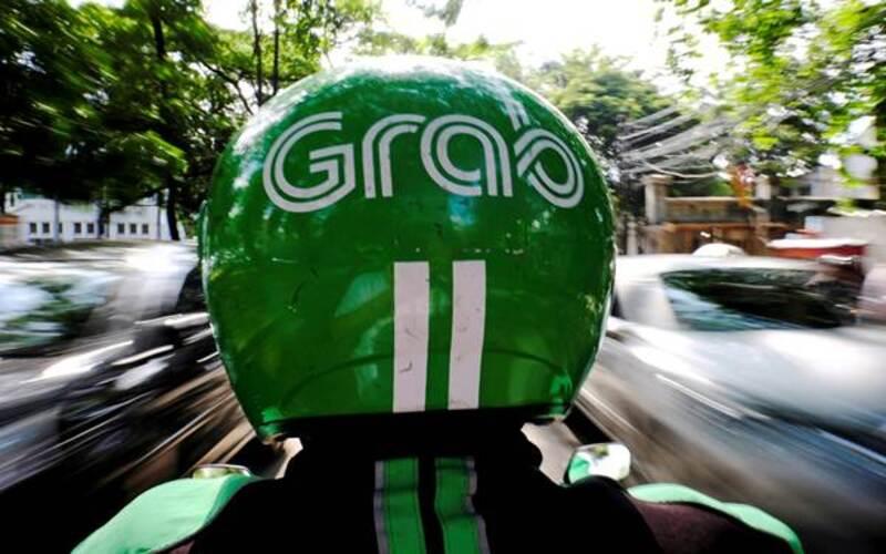 Ilustrasi pengemudi ojek daring Grab. - Reuters/Beawiharta
