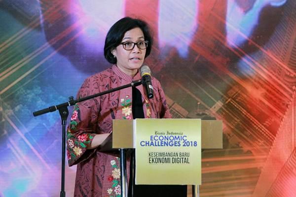Menteri Keuangan Sri Mulyani Indrawati memberikan paparan pada acara Bisnis Indonesia Economic Challenges 2018 di Jakarta, Senin (4/12). Acara tersebut mengambil tema Keseimbangan Baru Ekonomi Digital.  JIBI/Bisnis/Dwi Prasetya
