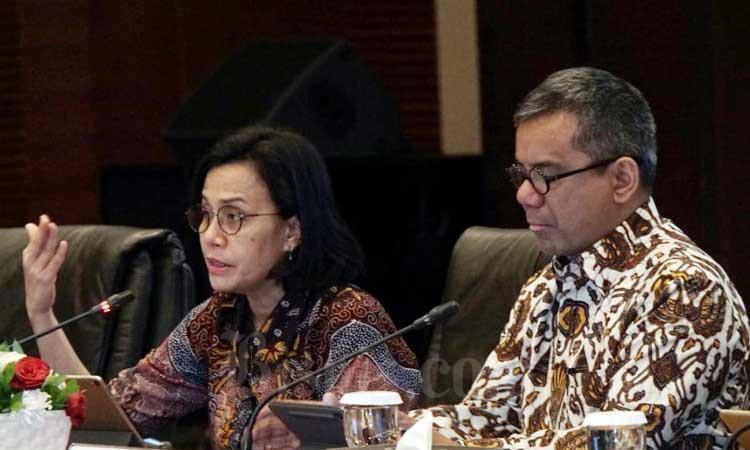 Menteri Keuangan Sri Mulyani Indrawati (kiri) didampingi Wakil Menteri Keuangan Suahasil Nazara memberikan pemaparan dalam konferensi pers di Jakarta, Rabu (19/2/2020). Kementerian Keuangan menyampaikan penerimaan pajak sampai dengan 31 Januari 2020 ditopang PPh Non Migas sebesar Rp46,2 triliun atau sudah terealisasi 5,3 persen dari target dan PPN senilai Rp30,5 triliun atau terealisasi 4,4 persen dari target. Bisnis/Himawan L Nugraha