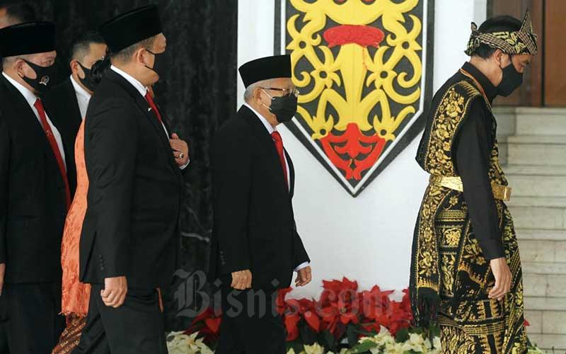 Presiden RI Joko Widodo didampingi Wakil Presiden Maruf Amin saat tiba di Ruang Rapat Paripurna I, Kompleks Parlemen, Jakarta, Jumat (14/8/2020). Bisnis/Arief Hermawan P nn