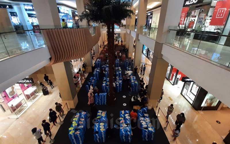Suasana salah satu pusat perbelanjaan di Jakarta, Selasa (2/3/2021). Asosiasi Pengelola Pusat Belanja Indonesia (APPBI) menyampaikan bahwa vaksinasi Covid-19 mandiri bagi karyawan merupakan langkah awal untuk kembali menggairahkan bisnis di pusat perbelanjaan atau mal. Adapun selama pandemi mal menjadi salah satu sektor yang terpuruk karena berkurangnya tingkat kunjungan.Bisnis/Himawan L Nugraha