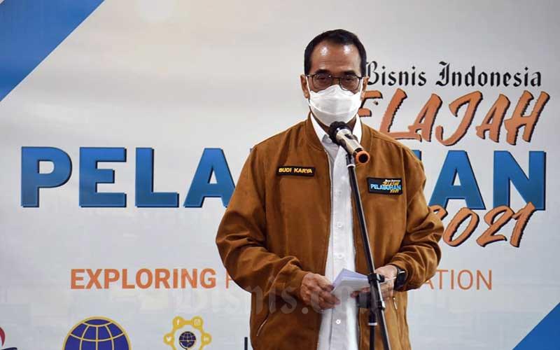 Menteri Perhubungan Budi Karya Sumadi memberikan sambutan saat pelepasan tim jelajah pelabuhan Bisnis Indonesia di Jakarta, Senin (5/4/2021). Kegiatan yang bertema Exploring Port Digitalization bertujuan untuk mengupas pelabuhan dari beragam sisi, mulai dari aktivitas kepelabuhanan, transformasi digitalnya, hingga ekosistem yang terlibat di pelabuhan. Bisnis/Abdurachman