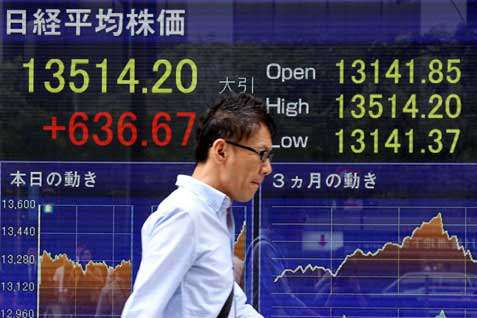 Papan monitor salah satu Bursa Asia. Indeks MSCI Berfluktuasi  ke level 138,62 - Reuters