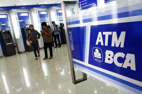 Gerai ATM BCA. Harga saham BBCA tertekan akibat mencuatnya kasus pajak - Bisnis