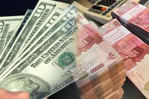 Mata uang dolar AS dan rupiah. Pelemahan kurs masih wajar - JIBI