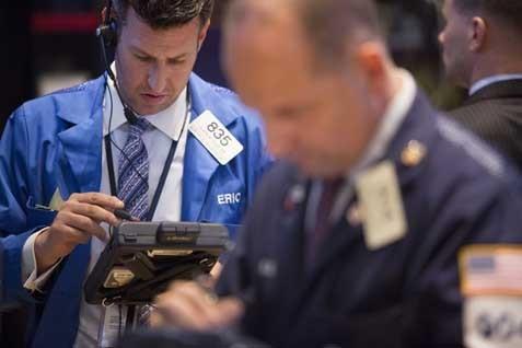 Saham Apple naik 8,2%. Sementara itu saham Verizon Communications Inc memimpin penurunan di indeks Dow Jones Industrial Average.  - bisnis.com