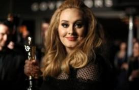 Adele Dinobatkan Sebagai Penulis Lagu Terbaik