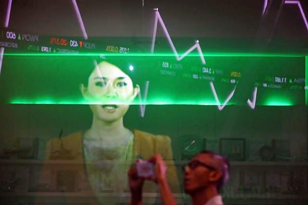 Papan elektronik menampilkan pergerakan indeks harga saham gabungan (IHSG) di gedung Bursa Efek Indonesia Jakarta. - JIBI/Dwi Prasetya