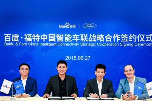Ya-Qin Zhang, President of Baidu; Tan Su, General Manager of Baidus Internet of Vehicles Division; Robert Hou, Director of Mobility Platforms and Products, Ford Asia Pacific; Peter Fleet, Ford Group Vice President and President of Ford Asia Pacific.  - Ford