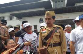 "Ini Alasan Presiden Jokowi Pakai Baju Pejuang dan Bawa ""Pistol"""