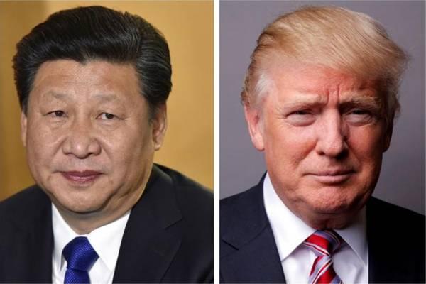Presiden China Xi Jinping (kiri) dan Presiden AS Donald Trump. - .Reuters/Toby Melville