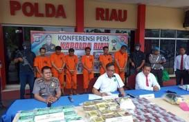 Polda Riau Gagalkan Penyelundupan 32 Kg Narkotika dan 20.000 Pil Happy Five