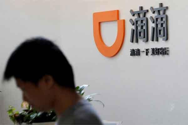 Logo Didi Chuxing tampak di kantor pusatnya di Beijing, China, 18 Mei 2018.  - Reuters