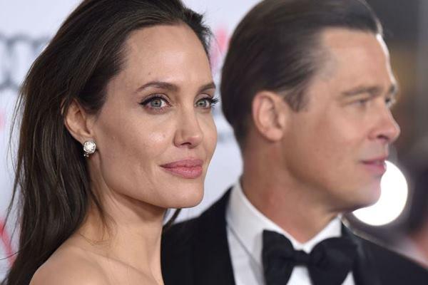 Angelina Jolie dan Brad Pitt - redbookmag.com