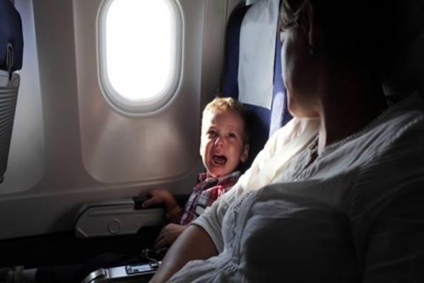Bayi menangis di dalam pesawat - Istimewa