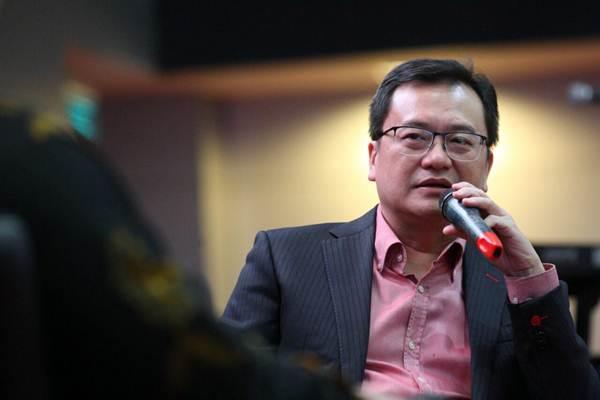 Benny Tjokrosaputro, ketika masih menjabat sebagai Komisaris Utama PT Hanson International Tbk., memberikan penjelasan pada seminar Fundamental Step for Better Future di Jakarta, Rabu (7/3/2018). - JIBI/Dedi Gunawan
