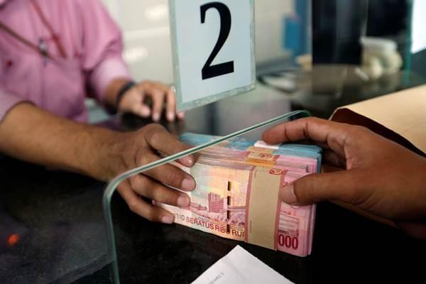 Transkasi penukaran uang rupiah di sebuah money changer di Jakarta, Selasa (4/9/2018). - Reuters/Willy Kurniawan