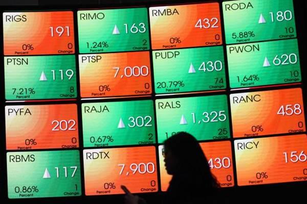 Papan monitor menampilkan pergerakan indeks harga saham gabungan (IHSG) di gedung Bursa Efek Indonesia Jakarta, Kamis (27/7). - JIBI/Dwi Prasetya