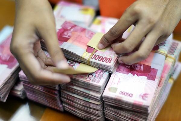 Uang rupiah. - Bloomberg/Brent Lewin
