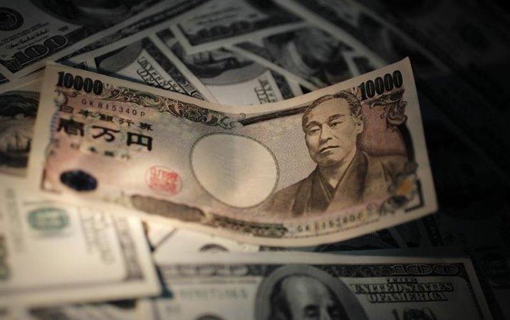 Uang Yen Jepang dan Dolar Amerika Serikat - Reuters/Yuriko Nakao