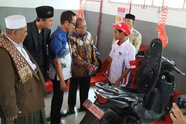 Ahmad Muhibbuddin, GM PT Astra Honda Motor (HM) di Bengkel Praktik SMK Jaya Buana, Tangerang, SAbtu (22/6 - 2019).