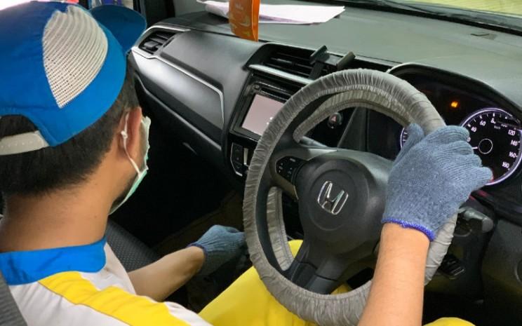 Program Home Service Honda saat ini didukung sebanyak 118 dealer di berbagai kota di Indonesia untuk melayani konsumen yang membutuhkan perawatan atau perbaikan mobil tanpa meninggalkan rumah masing-masing. - HPM/Bisnis.com