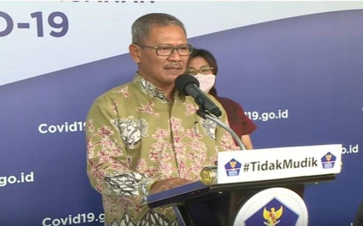 Juru Bicara Pemerintah untuk Penanganan Covid-19 Achmad Yurianto, Selasa (14//4/2020), memberi keterangan di BNPB, Jakarta. JIBI - Bisnis/Nancy Junita