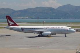 Dampak Covid-19, Penumpang Cathay Pacific Anjlok 99…