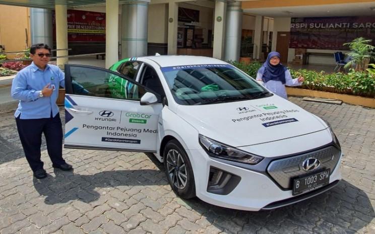 Hyundai Ioniq Electric untuk tenaga kesehatan beroperasi sejak 27 April hingga 26 Juni 2020 dengan jam operasional 06.00 hingga 22.00 WIB. / Bisnis.com