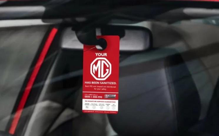 Tag penanda bahwa unit mobil MG telah lolos proses sanitasi sebelum pengiriman / ANTARA
