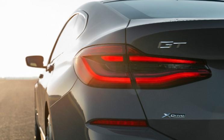 The new BMW 640i xDrive Gran Turismo, Bernina Grey Amber effect, M Sport package (05/2020).  - BMW