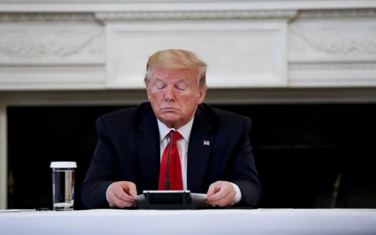 Presiden Trump memimpin pertemuan dengan petinggi sejumlah industri di AS, Rabu (29/4/2020) - Bloomberg / Stefani Reynolds