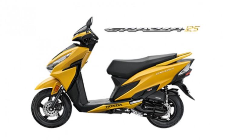 Honda Grazia. Motor yang berkapasitas mesin 125 cc ini memiliki sistem pengereman yang mengandalkan kombinasi cakram dengan teromol serta sistem CBS atau Combi-Braking System. - HONDA