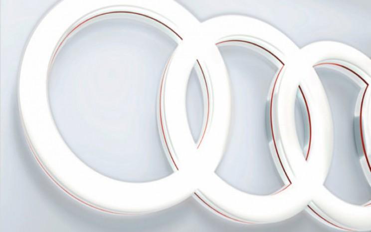 Logo Audi AG. Rapat Umum Pemegang Saham pada 31 Juli 2020 mengagendakan restrukturisasi perusahaan.  - AUDI AG