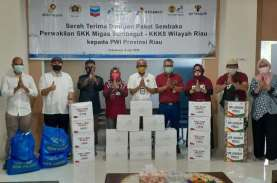 SKK Migas - KKKS Serahkan Paket Sembako ke PWI Riau