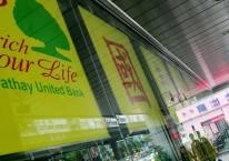 Reklame Cathay Financial Holding Co tampak di kantor cabang Fu-Xing, Taipei, Taiwan beberapa waktu lalu/Bloomberg-Maurice Tsai. Financial Holding Co adalah induk dari Cathay Life Insurance Co Ltd, yang berencana menjadi pemegangsaham terbesar PT Bank Mayapada Tbk. milik Dato Sri Tahir