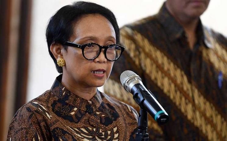 Menteri Luar Negeri Retno LP Marsudi memberikan pernyataan pers terkait larangan masuk sementara bagi warga negara asing ke Indonesia di Kantor Kementerian Luar Negeri Jakarta, Kamis (5/3/2020). ANTARA FOTO - Wahyu Putro A