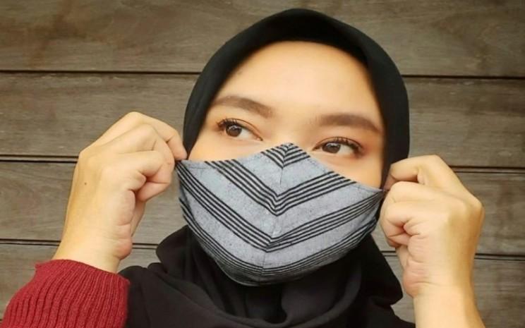 Masker kain Aruna. - ilustrasi masker kain