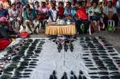 Potret Merawat Tradisi Kapak Batu di Tanah Papua