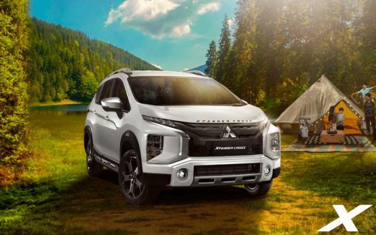 Mitsubishi Xpander Cross. Model kendaraan serbaguna Mitsubishi masuk 10 besar kendaraan dengan pengiriman dari pabrikan ke dealer terbanyak pada September 2020.  - MITSUBISHI