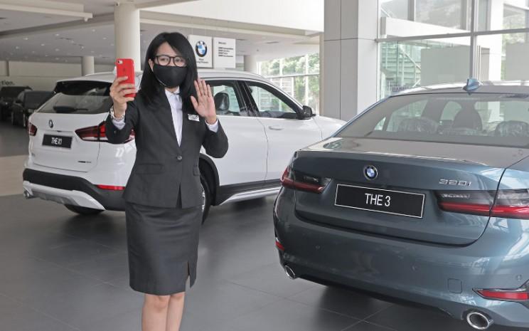 Showroom BMW. Keterbukaan informasi dan kemudahan untuk berkomunikasi adalah kunci di samping infrastruktur teknologi yang canggih.  - BMW