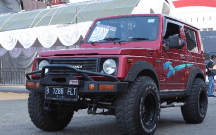 Ilustrasi Suzuki Jimny. Sejak generasi pertamanya meluncur di Indonesia pada tahun 1979, Jimny dikenal sebagai mobil off-road yang terbukti lincah dan tangguh mengarungi berbagai medan ekstrem.   - Suzuki.