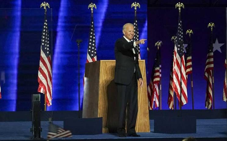 Presiden terpilih AS Joe Biden manyapa pendukungnya di Wilmington, Delaware, AS, Sabtu (7 /11/2020). Bloomberg - Sarah Silbiger\\r\\n
